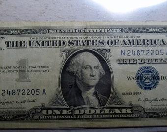 1957 A blue seal silver certificate one dollar (#E61ae)