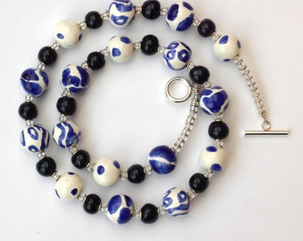 Fair trade ceramic bead Kazuri necklace, hand made and hand painted blue and white beads