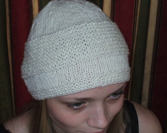 White cloche style hat which is hand knit in a beautiful Wool and Silk blend