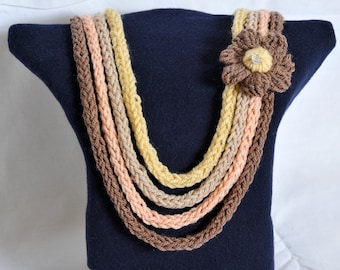 Hand made wool knitted necklace in soft colours