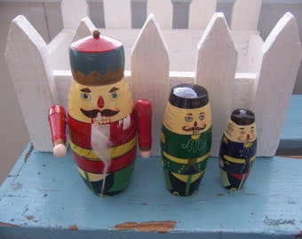 a king and two gentlemen nesting dolls
