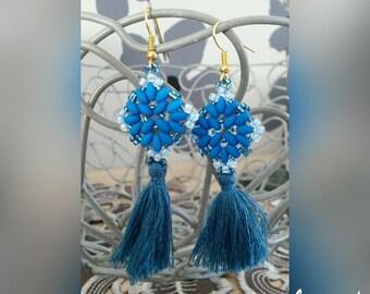 a beautiful pair of earrings manda blue