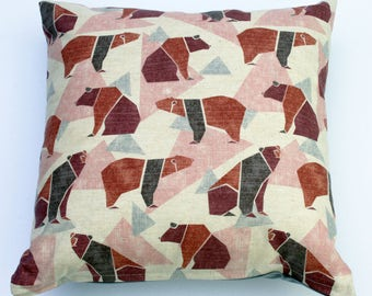 Scandinavian style bear print cushion in pink and grey