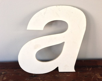 A - Reclaimed metal letter