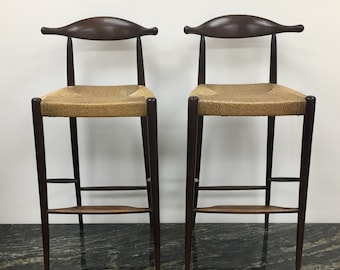 Pair of mid century Danish modern bar stools in the style of Hans Wegner and Arthur Umanoff