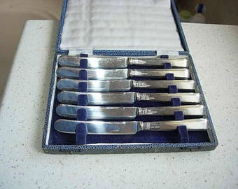 box of silver handled desert knives