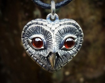 Owl necklace, silver and garnet heart shaped owls head pendant.