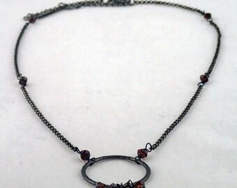 """Drops of Jupiter Necklace in Garnet - 18"""" gunmetal and garnet necklace"""