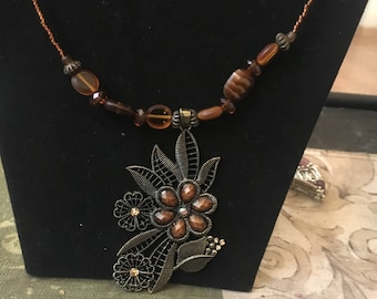 Brown and gold flower pendant beaded necklace and earrings set