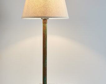 Table lamp, solid Iroko wood, toggle switch, and braided textile cable.