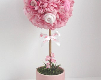Baby shower centerpiece, baby girl shower topiary, foot prints baby centerpiece, sock flowers topiary.
