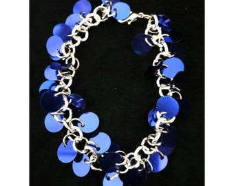 Blue sequin bracelet on silver colored chain