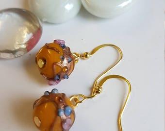 Boucles d'oreilles pendantes perle type de verre à la main