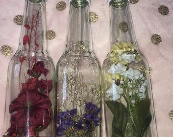 Glass bottle with flowers inside