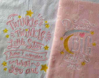 Blanket with embroidered nursery rhyme