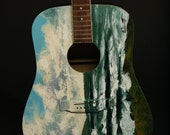 Atlantic Blues by Rod Coyne painted on an old acoustic guitar