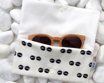 Glasses case with press button