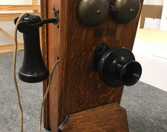 1919 Western Electric hand crank wall phone oak case 9w19h8d Shipping is not free