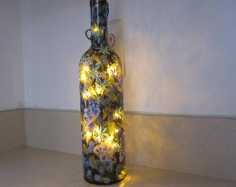 ON SALE Brown Wine Bottle with hand painted blue/sliver Wild Flowers leaves througout the bottle silver/blue baby breath white lights inside