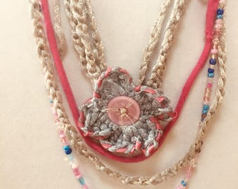 boho-chic multi-media necklace with detachable flower pin.