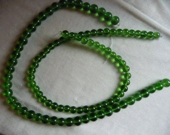 2 Strands of Glass Beads, Shades of Green. Sold per 16 inch strands. The strands are 8mm and 10mm round beads.