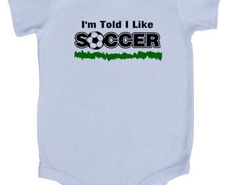 I'm Told I Like Soccer Silhouette Baby Bodysuit