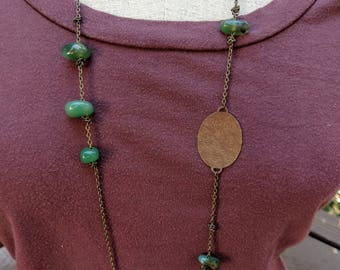 Green agate and textured bronze long necklace