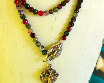 Handmade Sterling silver leaf closure, crucifix and Our Lady of Perpetual Help. Tourmaline multi colored faceted beads.