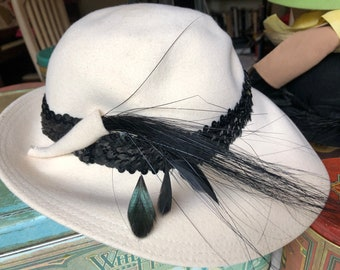 One White and One Black Vintage Hat. Sold as pair.