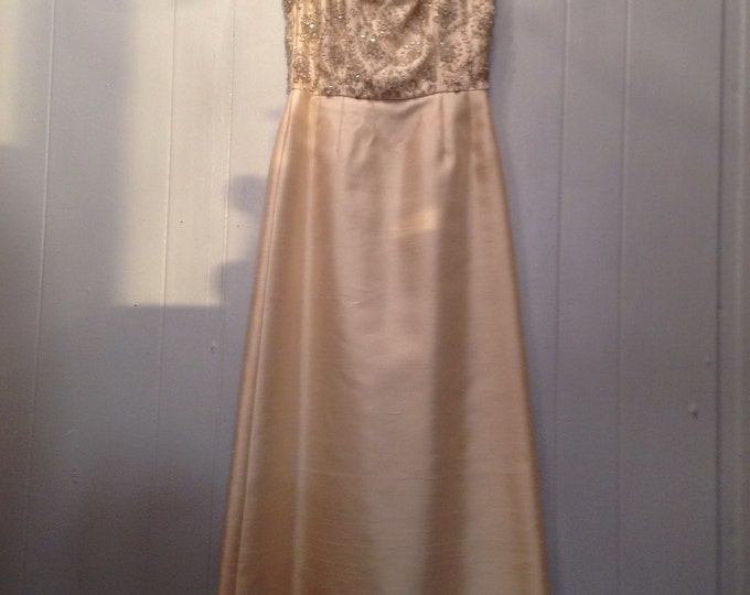 1960s handmade satin ball gown with rhinestones and drop crystals.