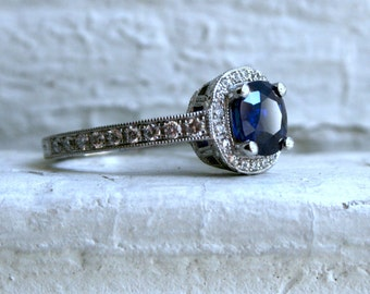 Stunning Halo Pave Diamond and Sapphire Ring.