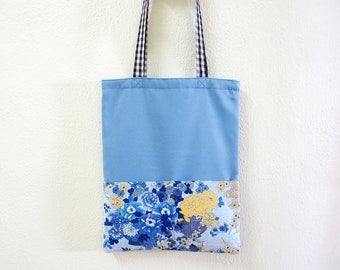 Unique tote bag in sky blue with blue Japanese floral bouquet patterned pockets