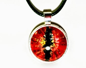 Phoenix2dragons collection. OOAK hand painted and etched design on 25 mm glass cabochon set in silver color bezel. Red dragon eye pendant.