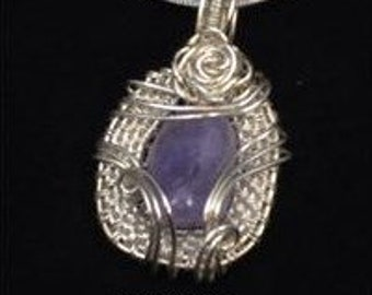 Sterling silver amethyst wire wrapped pendant on a sterling silver chain