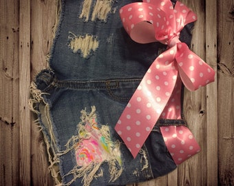 Bright floral patch distressed shorts