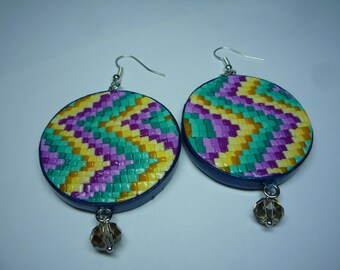 Round earrings made of polymer clay in blue violet