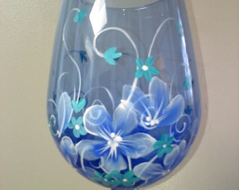 Hand painted wine glass in blue floral