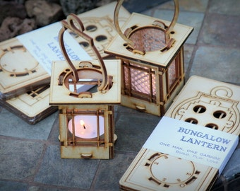 Craftsman Style Luminaires.  String Light lanterns give off warm light while hanging or resting on a table. DIY kits you snap together!