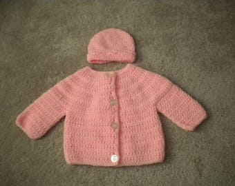 Crocheted baby hat and sweater