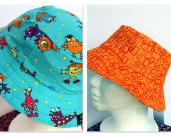 Blue Monster Reversible Boys Hat -sizes 6 mths - 8 yrs - orange geometric
