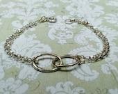 Silver interlocked bracel...