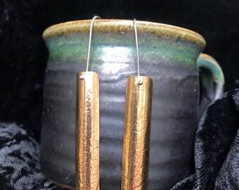 Curved brass leaf imprint earings