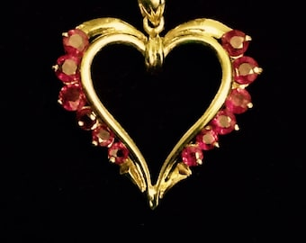 14k Gold Pendant. 12 Beautifully Red Rubies