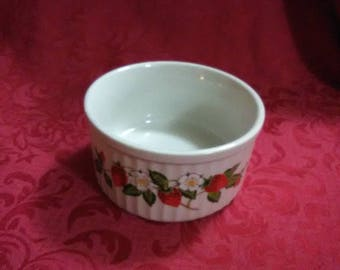 Vintage miniature casserole dish. Made by strawberries and cream. Has strawberry and white flower design.