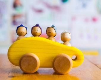 Yellow wooden minibus, wooden car by l'Atelier Cheval de bois