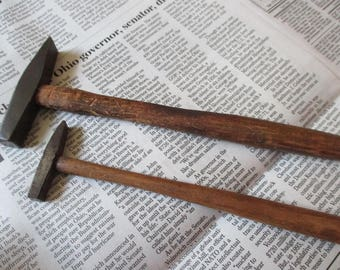 pair of vintage tack hammers wood handles small and large