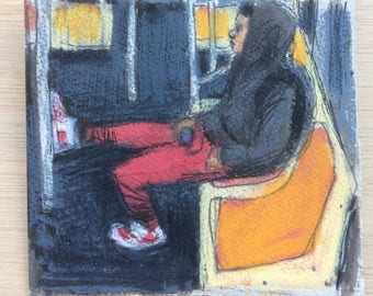 Subway rider with red pants