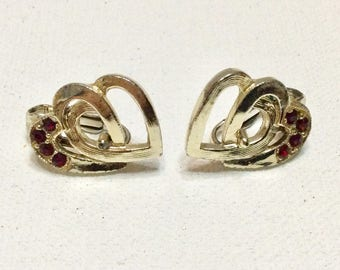Vintage double entwined hearts with red rhinestones clip on earrings.