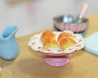 Dollhouse Miniature croissants in a pink oval cake stand