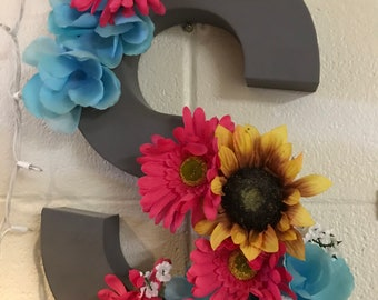 Hollow cardboard letter with flowers